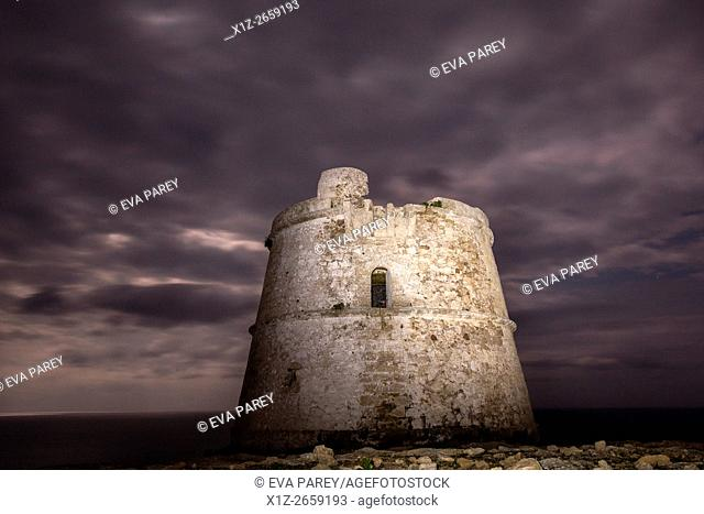 The tower of Es Garroveret at night, close to the lighthouse of Es Cap de Barbaria. (Formentera, Balearic Islands)