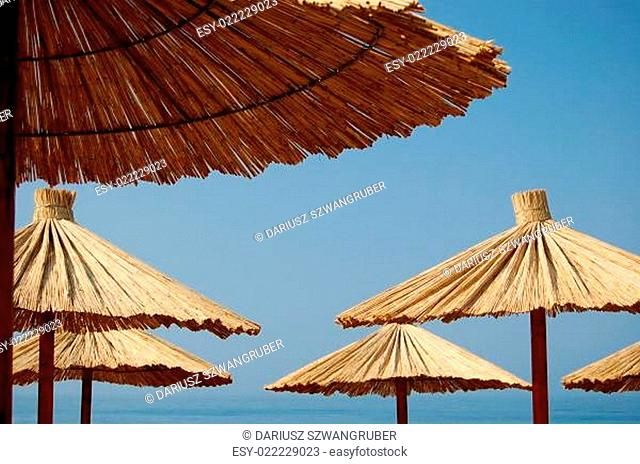 Straw umbrellas on Montenegrin beach
