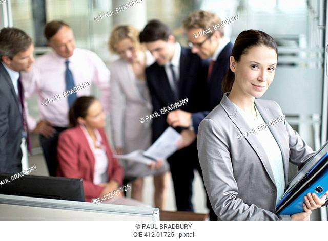 Business woman smiling in office