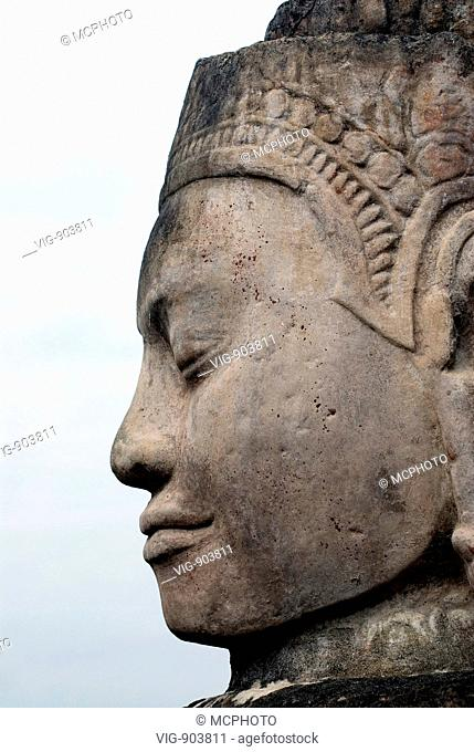 This stock photo shows a close up of a temple stone sculpture in profile at the famous Angkor Wat Temple near Siam Reap in Cambodia