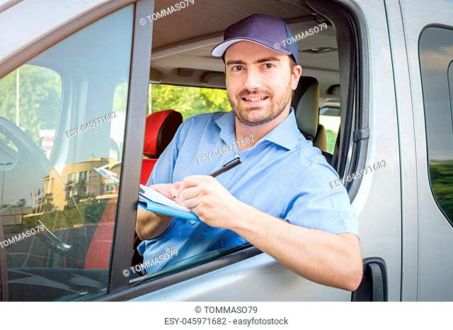 Portrait of confidence express courier on his delivery van