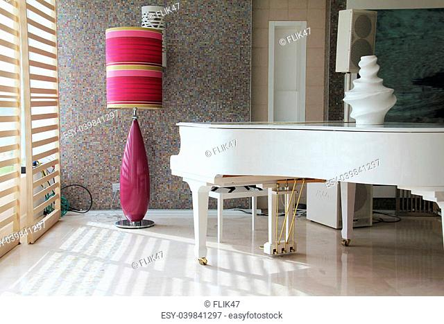 White grand piano on ceramic tiled floor