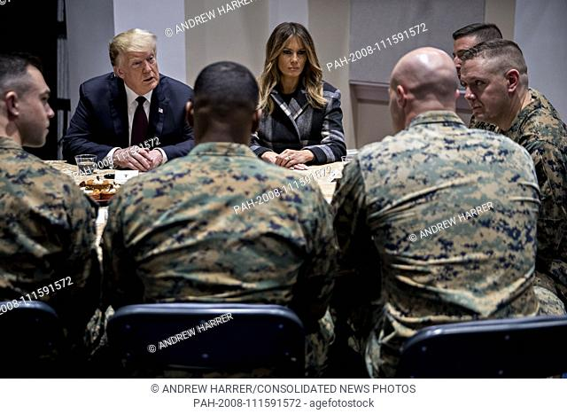 United States President Donald J. Trump, left, and First Lady Melania Trump, center, listen while speaking to Marines at Marine Barracks in Washington, D