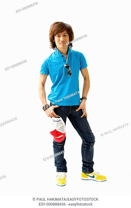 Handsome Asian man standing wearing casual clothes, isolated