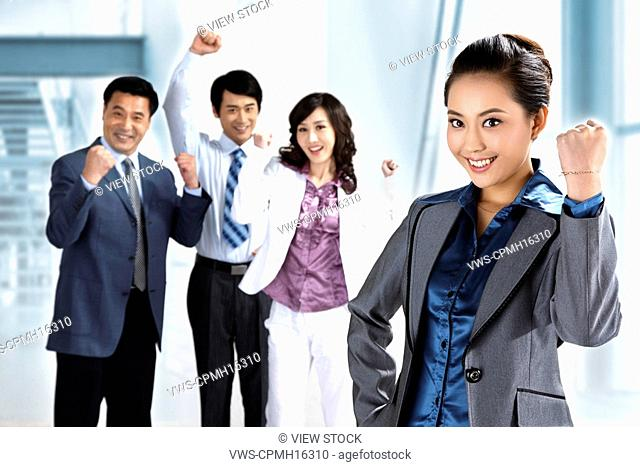 Businesspeople raising hands,cheering
