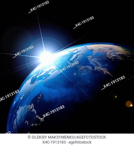 Sunrise over the Earth globe with bright sun flare isolated on black background