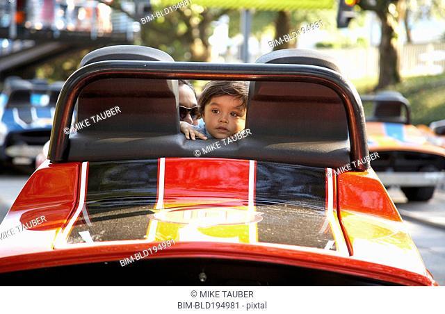 Child and parent in bumper car