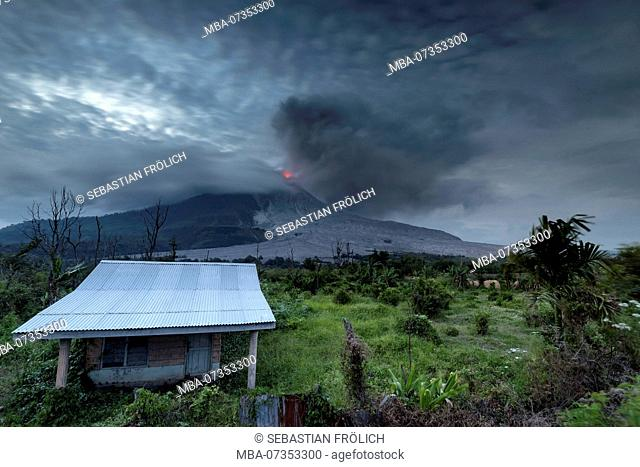 Abandoned family house in the red zone around the Sinabung on Sumatra, Indonesia