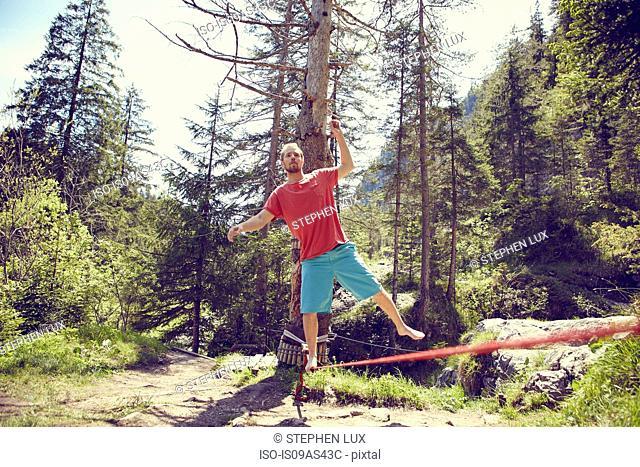 Man balancing on rope, Ehrwald, Tyrol, Austria