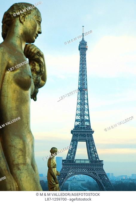 Eiffel tower, view from Palais Chaillot, Trocadéro, columns and statue, Paris France