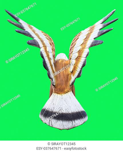 turn back Eagle or Falcon statueIsolated on green screen chroma key background