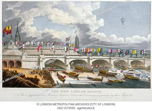 Opening of the new London Bridge by King William and Queen Adelaide, 1831. In the foreground figures stand on the riverbank and on decorated barges looking...
