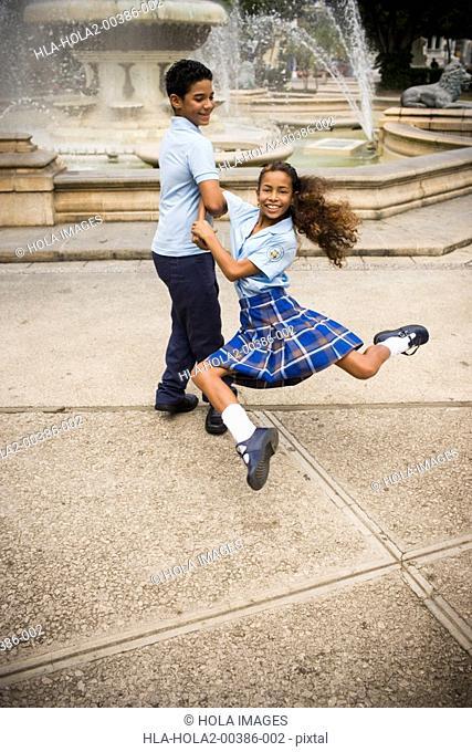 School children dancing salsa in center plaza