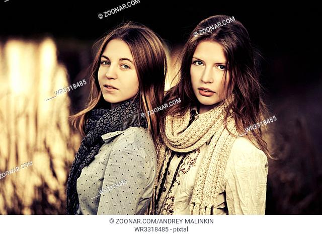 Two young fashion girls on nature
