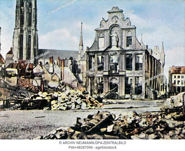 A contemporary German colorized propaganda photo shows the town center destroyed by German attacks in Mechelen, Belgium, 1914. The belfry of S