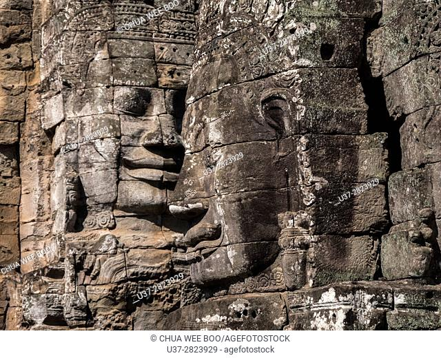 Angkor Temples - stone faces of Bayon Temple towers, Angkor Thom, Cambodia, Asia