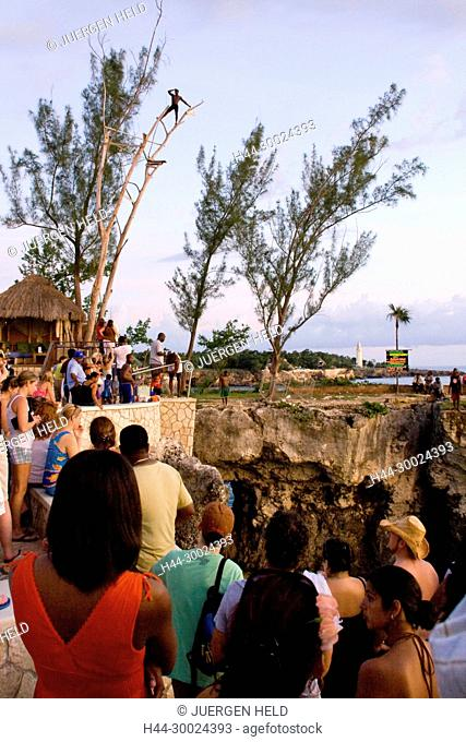 Jamaica Negril Ricks Cafe Cliff Diver jumping from a Tree, crowd