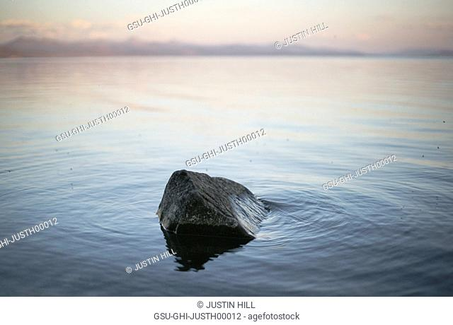 Rock in Middle of Calm Lake