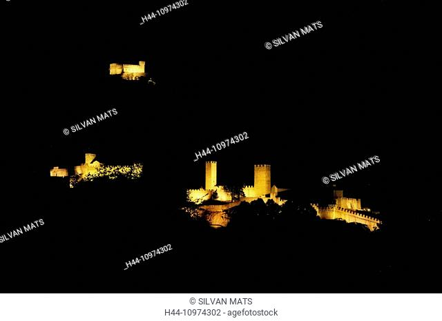 Three castles illuminated at night in Bellinzona, Switzerland