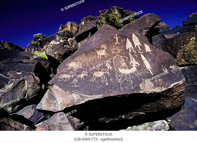 Petroglyphs in Sheep Canyon, Site Iny 9B in the Coso Mountains, of California. Patterned-body anthropomorphic figures are thought to be self-portraits made by...