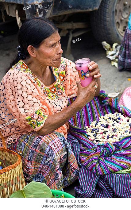 Woman selling dried beans
