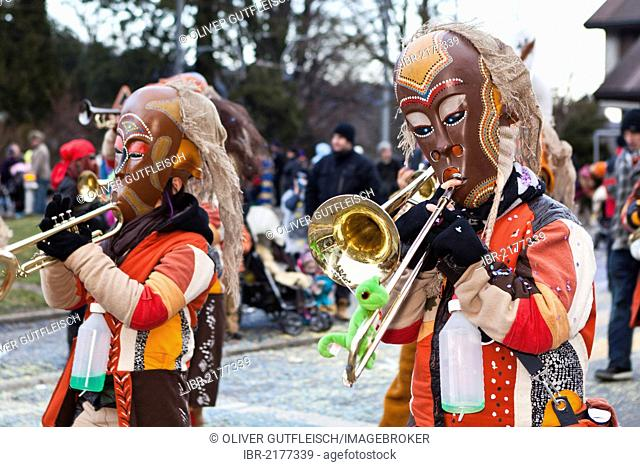 Guggen music band dressed up as indigenous Australians, Aborigines, 35th Motteri-Umzug parade in Malters, Lucerne, Switzerland, Europe