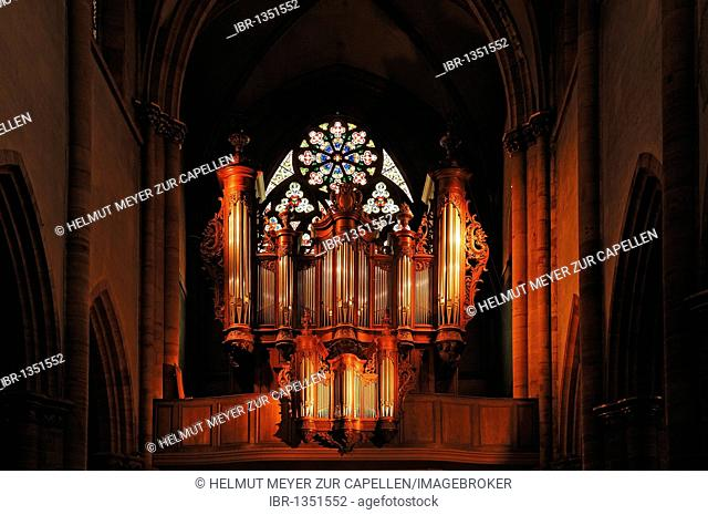 Illuminated old organ in the cathedral of St. Martin, 22 Place de la Cathédrale, Colmar, Alsace, France, Europe