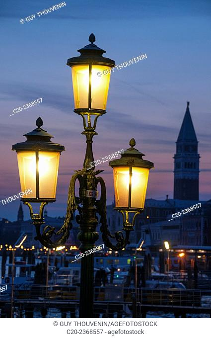 Lit lamposts on San Marco basin, and campanile, San Marco, Venice, Italy