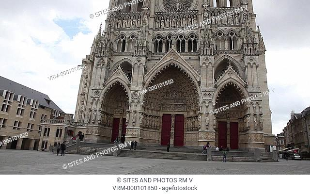 TILT up. Daylight. Exterior: West facade and the three porches of the main portal. The Cathedral is in the High Gothic or Classical French style