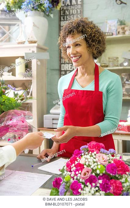 Mixed race woman working in florist shop