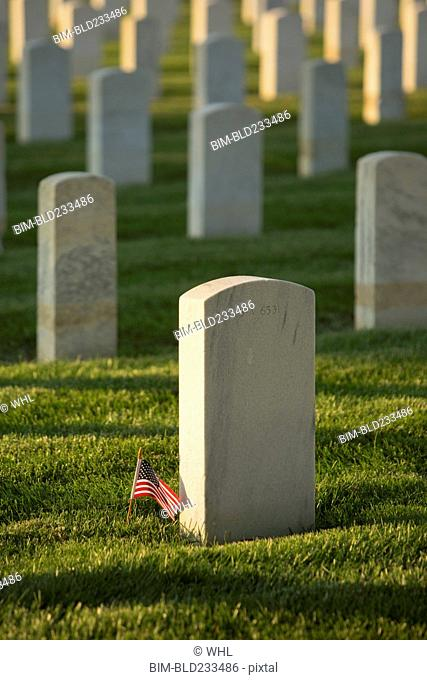 American flag at cemetery gravestone