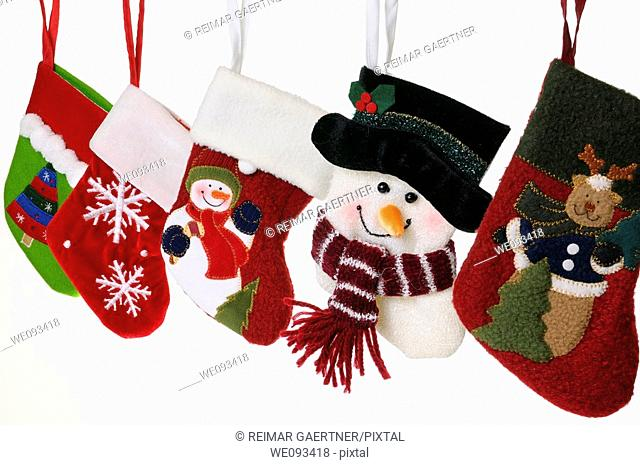 Collection of unique Christmas stockings with snowmen hanging on white background sharp