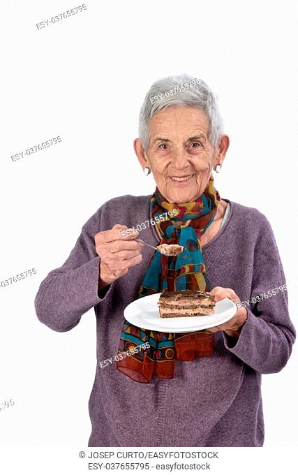 Older woman eating a piece of cake