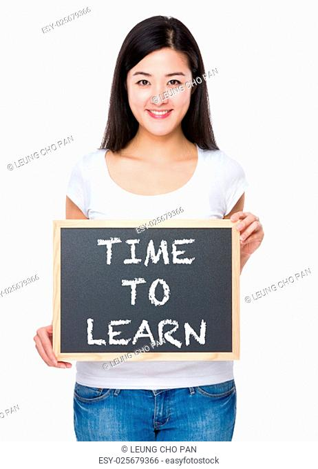 Student with chalkboard showing phrase time to learn