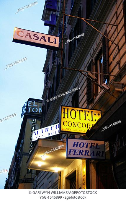 hotel signs at night in the termini district rome italy