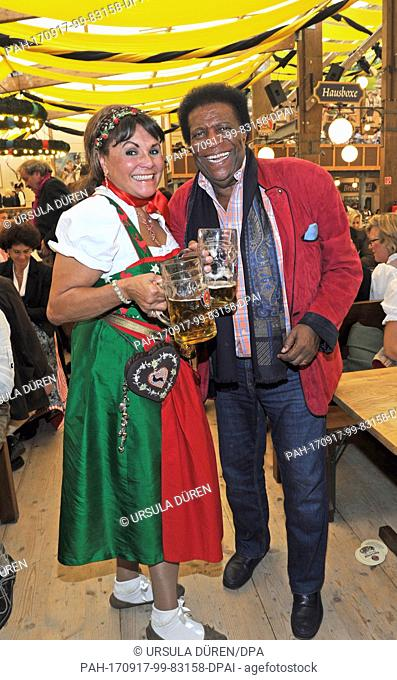 Singer Roberto Blanco and his sister Antonia celebrate in the Winzerer Faehndl (Paulaner brewery beer tent) on the opening day of the Oktoberfest fun fair...