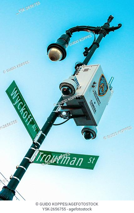 New York City, USA. Multiple security camera's mounted on a streetsign in Buschwick, Brooklyn