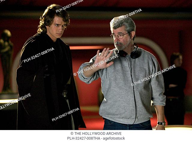 Hayden Christensen (Anakin Skywalker) listens as Director George Lucas describes the flow of the next shot in Star Wars: Episode III Revenge of the Sith