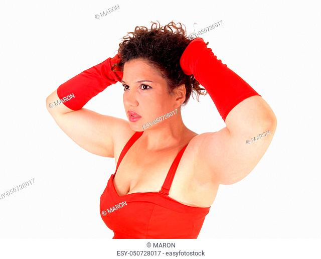 A beautiful closeup image of a lovely woman in a red dress and cloves, whit her hands on her head, isolated for white background
