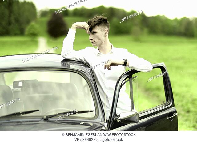 young man with car at countryside, in Bad Tölz, Germany
