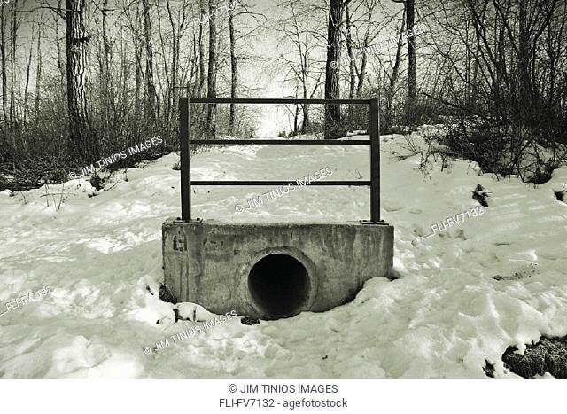 FV7132, Jim Tinios, Landscape of Drainage Pipe in Winter, B/W