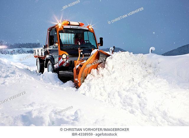 Snowplow removing snow, winter maintenance, Inn Valley, Kufstein district, Tyrol, Austria