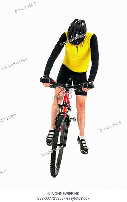 Active mountain biker standing in studio isolated over white background
