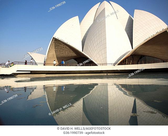 People walking on bridge leading towards Lotus temple in New Delhi, India