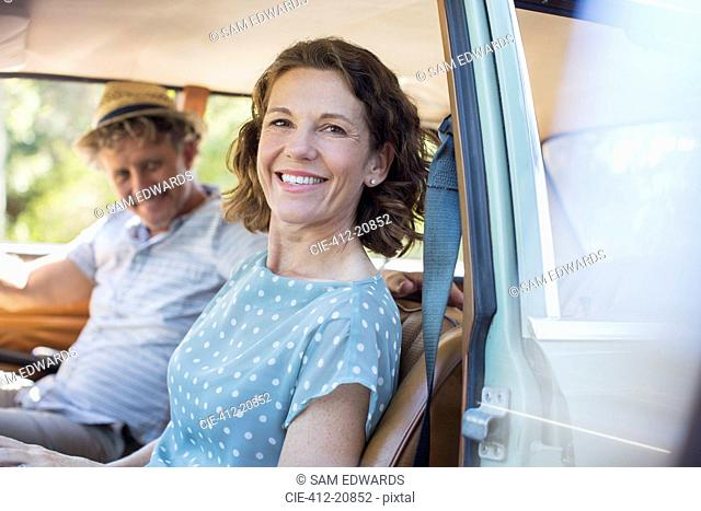 Older couple sitting in front seat of car