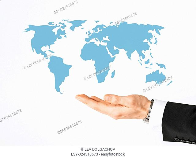 people and business concept - close up of businessman hand showing world map