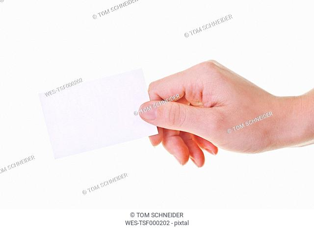 Human hand holding business card, close-up
