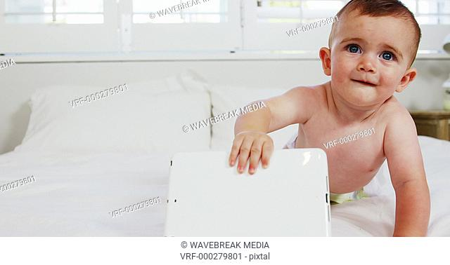 Cute baby holding a tablet