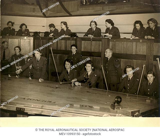WAAF Plotters at work in the Operations Room of an RAF Station Fighter Command. c.November 1942