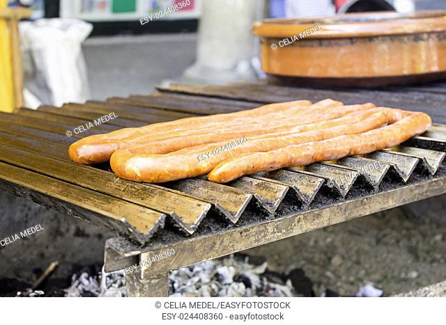 Fried sausage on barbecue, restaurant and food